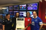 Rebecca Pow with staff at William Hill